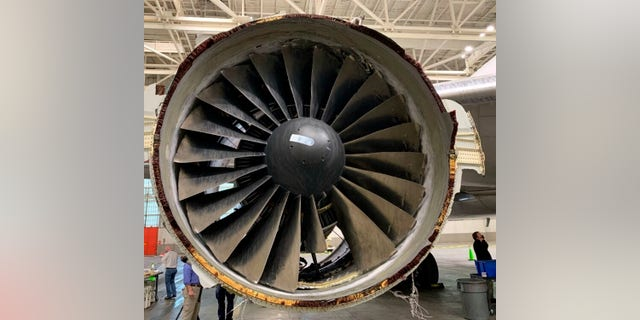 This photo provided by The National Transportation Safety Board shows the damaged engine of United Airlines Flight 328. (Associated Press)