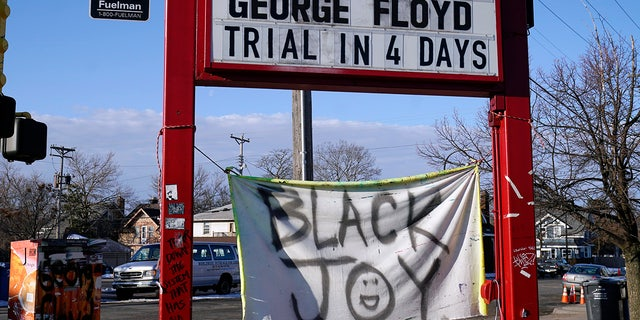 A trial countdown sign marks the days at George Floyd Square, March 4, 2021, in Minneapolis. (AP Photo/Jim Mone)