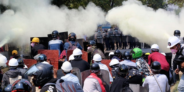 Anti-coup protesters discharge fire extinguishers to counter the impact of the tear gas fired by police during a demonstration in Naypyitaw, Burma, Monday, March 8, 2021. (AP Photo)