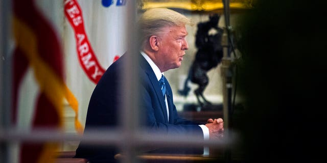 President Donald Trump addresses the nation from the Oval Office about the coronavirus outbreak at the White House, Wednesday, March 11, 2020, in Washington.
