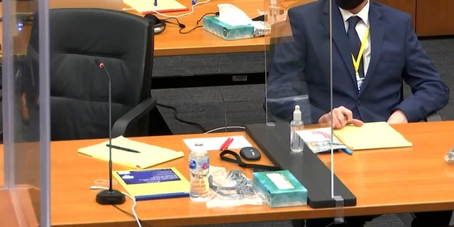 In this image from video, defendant, former Minneapolis police officer Derek Chauvin, right, listen as Hennepin County Judge PeterCahill presides over pretrial motions before jury selection, Monday, March 8, 2021, in the trial of former officer Chauvin, in the May 25, 2020, death of George Floyd at the Hennepin County Courthouse in Minneapolis, Minn. (Court TV, via AP, Pool)