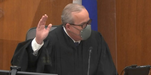 In this screengrab from video Hennepin County Judge PeterCahill swears in a potential juror as he presides over jury selection in the trial of former Minneapolis police officer Derek Chauvin on March 9 at the Hennepin County Courthouse in Minneapolis. Chauvin is charged in the May 25, 2020 death of George Floyd. (Court TV, via AP, Pool)