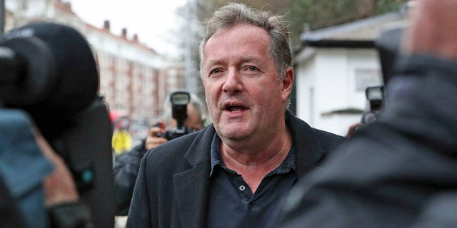 "British television host Piers Morgan speaks to reporters outside his home in Kensington, central London, Wednesday March 10, 2021. Morgan quit the ""Good Morning Britain"" program on Tuesday after making controversial comments about the Duchess of Sussex. The U.K.'s media watchdog said earlier Tuesday it was launching an investigation into the show under its harm and offense rules after receiving more than 41,000 complaints about Morgan's comments on Meghan. (Jonathan Brady/PA via AP)"