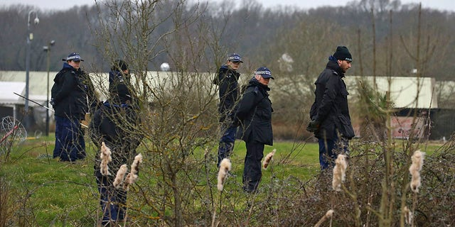 Officers from the Metropolitan Police search land near to Great Chart Golf and Lesiure, in connection with the disappearance of Sarah Everard, in Ashford, England, Wednesday March 10, 2021. Britain's Metropolitan police says an officer has been arrested in connection with the case of a woman who went missing in London last week.  (Gareth Fuller /PA via AP)