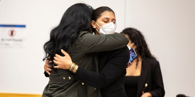 Des Moines Register reporter Andrea Sahouri, facing, hugs her mother, Muna Tareh-Sahouri, after being found not guilty at the conclusion of her trial at the Drake University Legal Clinic, Wednesday, March 10, 2021, in Des Moines, Iowa. An Iowa jury acquitted Andrea Sahouri, who was pepper-sprayed and arrested by police in the summer of 2020 while covering a protest in a case that critics have derided as an attack on press freedom and an abuse of prosecutorial discretion. (Kelsey Kremer/The Des Moines Register via AP, Pool)