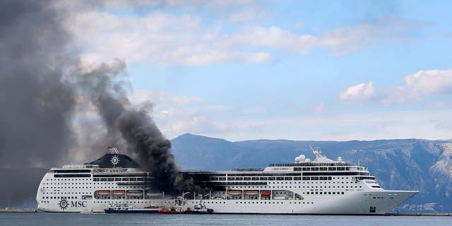 Firefighters on vessels try to extinguish a fire on a cruise ship at the port of Corfu, northwestern Greece, on Friday. (Stamatis Katopodis/InTime News via AP)