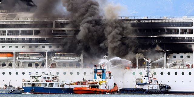 A fire broke out on the cruise ship docked in the port of Corfu as the 51 crew members on board were in good health, the coast guard said. (Stamatis Katopodis/InTime News via AP)