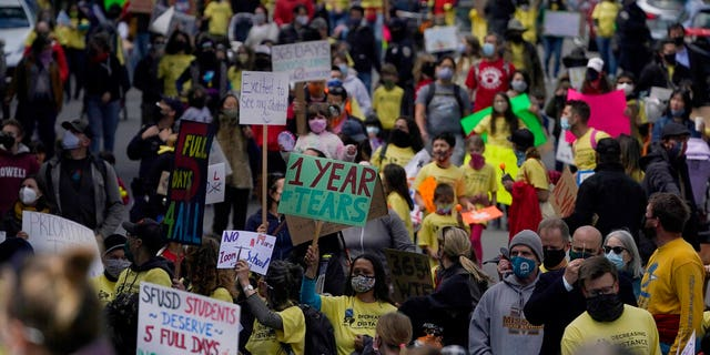 Parents, students, teachers and supporters march during a rally for San Francisco public schools to reopen during the coronavirus pandemic in San Francisco, Saturday, March 13, 2021.
