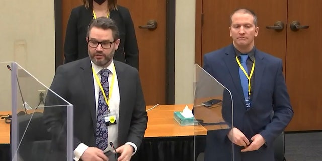 In this image taken from video, defense attorney Eric Nelson, left, and defendant former Minneapolis police officer Derek Chauvin, right, introduce themselves to potential jurors as Hennepin County Judge PeterCahill presides, prior to continuing jury selection, Monday, March 15, 2021, in the trial of Chauvin, at the Hennepin County Courthouse in Minneapolis, Minn. (Court TV, Pool via AP)