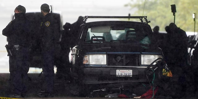 A car involved in a deadly accident sits at the scene Monday, March 15, 2021, in San Diego. A driver plowed through a crowd on a sidewalk in downtown San Diego on Monday morning, killing three people and injuring six others, including two who are hospitalized in critical condition, police said. (AP Photo/Gregory Bull)