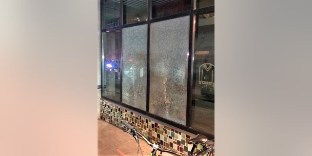 This photo released by Portland Police Bureau shows smashed windows left behind by people inside the perimeter of a march by a group of about 100 hundred protesters Friday night in Portland, Ore. Portland Mayor Wheeler on Monday, Mach 15, 2021 called for an end to violence and property destruction after businesses were damaged over the weekend. (Portland Police Department via AP, File)