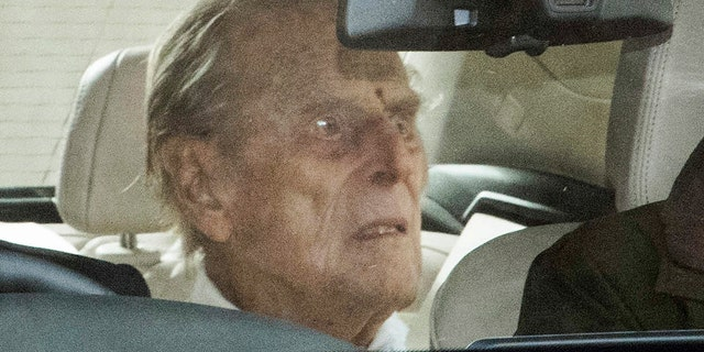 Britain's Prince Philip as he leaves the King Edward VII hospital in the back of a car in London, Tuesday, March 16, 2021. The 99-year-old husband of Queen Elizabeth II has been hospitalized after a heart procedure.