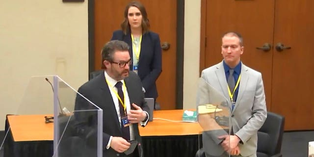 In this screen grab from video, defense attorney Eric Nelson, left, defendant and former Minneapolis police officer Derek Chauvin, right, and Nelson's assistant Amy Voss, back, introduce themselves to jurors as Hennepin County Judge PeterCahill presides over jury selection in the trial of Chauvin Wednesday, March 17, 2021 at the Hennepin County Courthouse in Minneapolis, Minn. Chauvin is charged in the May 25, 2020 death of George Floyd. (Court TV, via AP, Pool)