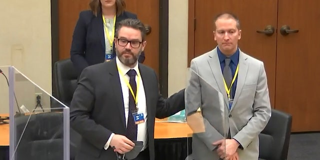 In this screengrab from video, defense attorney Eric Nelson, left, defendant and former Minneapolis police officer Derek Chauvin, right, introduce themselves to jurors as Hennepin County Judge PeterCahill presides over jury selection in the trial of Chauvin on Wednesday. On Thursday, a 12th juror was seated. (Court TV, via AP, Pool)