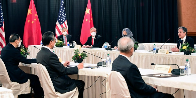 Secretary of State Antony Blinken, far right, speaks as Chinese Communist Party foreign affairs chief Yang Jiechi, left, and China's State Councilor Wang Yi, second from left, listen at the opening session of US-China talks at the Captain Cook Hotel in Anchorage, Alaska, Thursday, March 18, 2021. (Frederic J. Brown/Pool via AP)