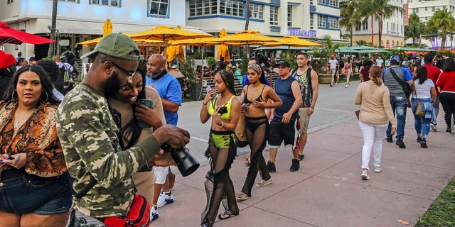 Despite the coronavirus, spring breakers return to South Beach and walk along Ocean Drive that is closed to traffic on Thursday, March 12, 2021.