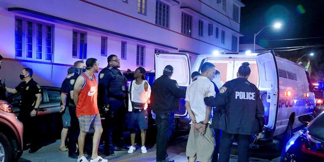 City of Miami Beach Police officers arrest several males on Ocean Drive and 10th Street as spring break has officially begun Saturday, Feb. 20, 2021 in Miami Beach, Fla.