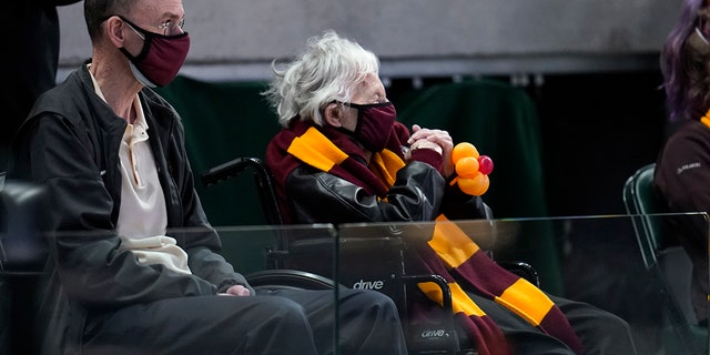 Sister Jean Dolores Schmidt watches Loyola Chicago play Illinois at Bankers Life Fieldhouse in Indianapolis, Sunday, March 21, 2021. (AP Photo/Paul Sancya)