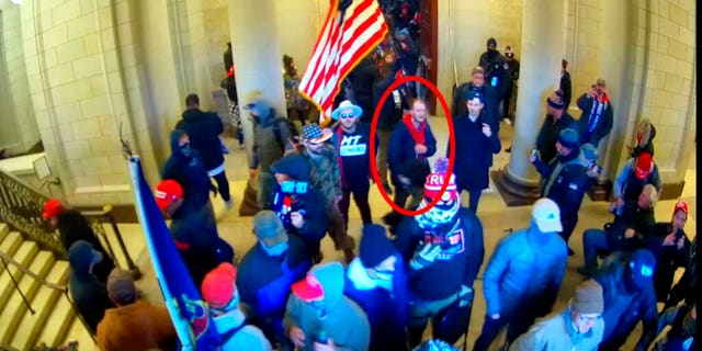 Ethan Seitz, 31, of Bucyrus, Ohio, outlined in red by the source, joins other rioters who stormed the U.S. Capitol on Jan. 6, 2021, in Washington.