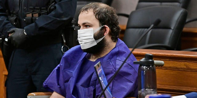 "Ahmad Al Aliwi Alissa, 21, appears before Boulder District Court Judge Thomas Mulvahill at the Boulder County Justice Center in Boulder, Colo. on March 25, 2021. Three days after he was led away in handcuffs from a Boulder supermarket where 10 people were fatally shot, Alissa appeared in court for the first time and his defense lawyer asked for a mental health assessment ""to address his mental illness."" (Helen H. Richardson/The Denver Post via AP, Pool)"