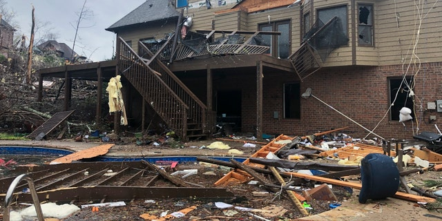 Damage is seen to a home after a tornado passed through the Eagle Point subdivision, Thursday, March 25, 2021, near Birmingham, Ala. (AP Photo/Butch Dill)