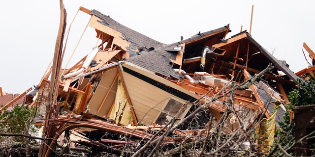 A house is totally destroyed after a tornado touches down south of Birmingham, Ala. in the Eagle Point community damaging multiple homes, Thursday, March 25, 2021.