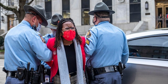 State Rep. Park Cannon, D-Atlanta, is placed into the back of a Georgia State Capitol patrol car after being arrested by Georgia State Troopers at the Georgia State Capitol Building in Atlanta, Thursday, March 25, 2021. (Associated Press)