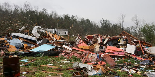 Piles of debris remain after a tornado touched down killing several people and damaging multiple homes Thursday, March 25, 2021 in Ohatchee, Ala. (Associated Press)