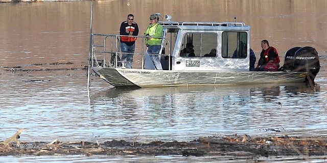 In this Wednesday, Dec. 4, 2019, photo, Missouri law enforcement personnel aided by the United State Geological Survey team use imaging sonar to try to locate the body of Mengqi Ji Elledge near Columbia, Mo. (Don Shrubshell/Columbia Daily TribuneTribune via AP)