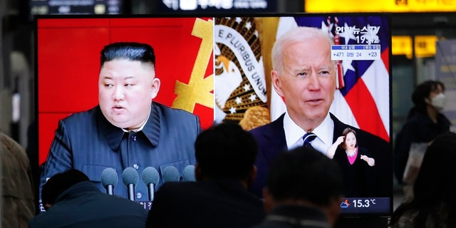Commuters watch a TV showing a file image of North Korean leader Kim Jong Un and U.S. President Joe Biden during a news program at the Suseo Railway Station in Seoul, South Korea, Friday. March 26, 2021. North Korea on Friday confirmed it had tested a new guided missile, as Biden warned of consequences if Pyongyang escalates tensions amid stalled nuclear negotiations. (AP Photo/Ahn Young-joon)