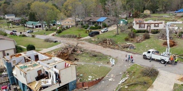 Drone images show the damaged to Trish Partridge's house at left and James Dunaway's home at right following a day of extended severe weather, Friday, March 26, 2021, in Pelham, Ala. (AP Photo/Vasha Hunt)