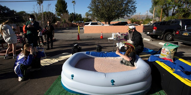 Barker sat in the tub of bean dip in front of Los Toros for 24 hours on Monday to raise awareness for the restaurant as it struggles during the coronavirus pandemic.