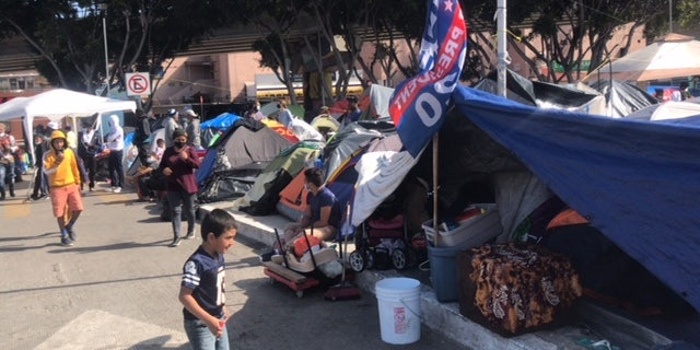 A Joe Biden campaign flag flies at a migrant camp near the U.S southern border. Republicans blame Biden's campaign rhetoric and policies for fueling the surge at the border. (Griff Jenkins/Fox News)