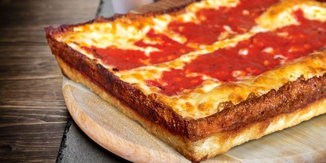 Detroit-style pizza is said to have been first developed by Buddy's pizza founder Gus Guerra and his wife Anna in 1946.  Buddy's also credits an employee named Concetta