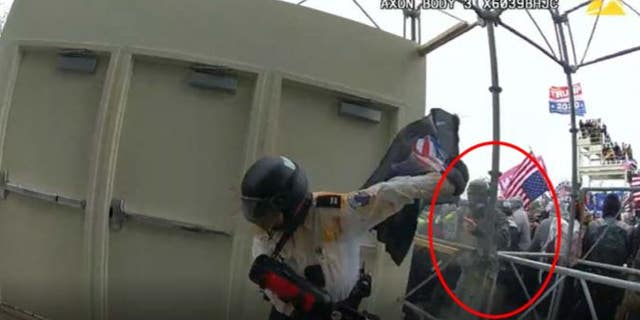 The image shows McKellop assaulting an officer with a flagpole, the FBI said.