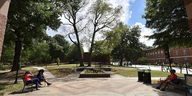 Students sit on the campus of Spelman College in Atlanta. (Hyosub Shin/Atlanta Journal-Constitution via AP, File)/Atlanta Journal-Constitution via AP)