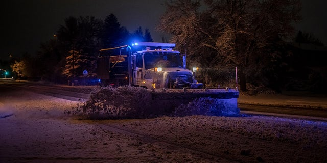 A snowplow clears streets of heavy snow during a winter storm in Boulder, Colorado, U.S., on Saturday, March 13, 2021. Photographer: Chet Strange/Bloomberg via Getty Images