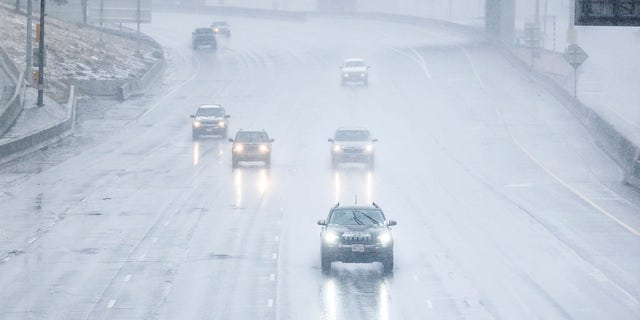 DENVER, CO - MARCH 13: Cars drive along I-25 as it starts to snow on March 13, 2021 in Denver, Colorado. (Photo by Michael Ciaglo/Getty Images)