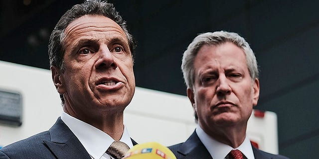 Governor of New York Andrew Cuomo stands with New York City Mayor Bill de Blasio at a news conference at the Time Warner Center on October 24, 2018 in New York City. (Photo by Spencer Platt/Getty Images)