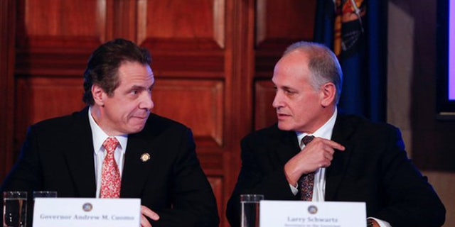 Gov. Andrew Cuomo and longtime friend Larry Schwartz (Source: AP)