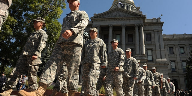 Members of the Colorado National Guard Honor Guard are seen here in September 2011. Colorado is activating the Guard this weekend ahead of a looming major winter storm. (The Denver Post via Getty Images)