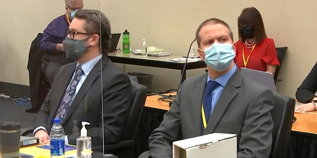 In this image from video, defense attorney Eric Nelson, left, and former Minneapolis police officer Derek Chauvin listen as Hennepin County Judge PeterCahill presides over pre-trial motions prior to opening statements, Monday March 29, 2021, in the trial of Chauvin, in the May 25, 2020, death of George Floyd at the Hennepin County Courthouse in Minneapolis, Minnesota