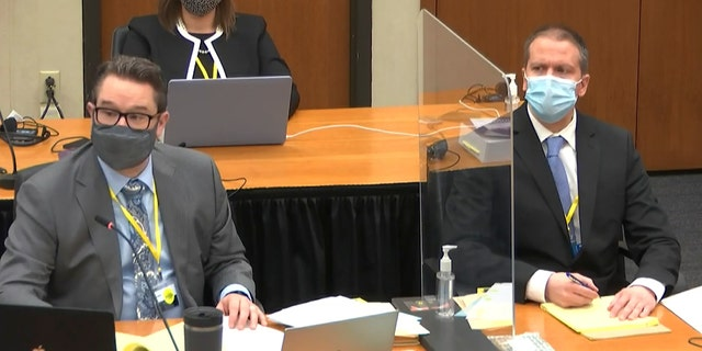 In this image from video, defense attorney Eric Nelson, left, and defendant former Minneapolis police Officer Derek Chauvin listen as Assistant Minnesota Attorney General Matthew Frank, questions witness Christopher Martin as Hennepin County Judge Peter Cahill presides Wednesday, March 31, 2021, in the trial of Chauvin at the Hennepin County Courthouse in Minneapolis, Minn. (Court TV via AP, Pool)