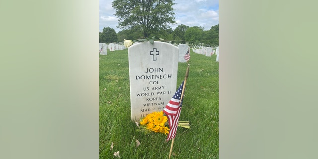 The headstone at Arlington Cemetery of Emily Domenech's grandfather