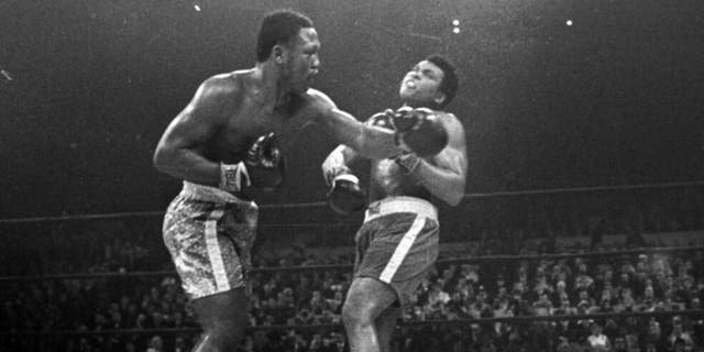 FILE - Joe Frazier hits Muhammad Ali with a left during the 15th round of their heavyweight title fight at New York's Madison Square Garden, in this March 8, 1971, file photo. Frazier was a relentless puncher filled with rage toward a fighter who couldn't help but belittle him.(AP Photo/File)