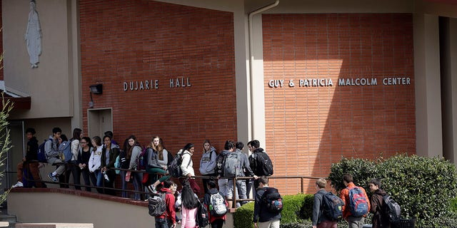 Students walk between buildings at St. Francis High School Friday, March 3, 2017, in Mountain View, Calif. (AP Photo/Marcio Jose Sanchez)