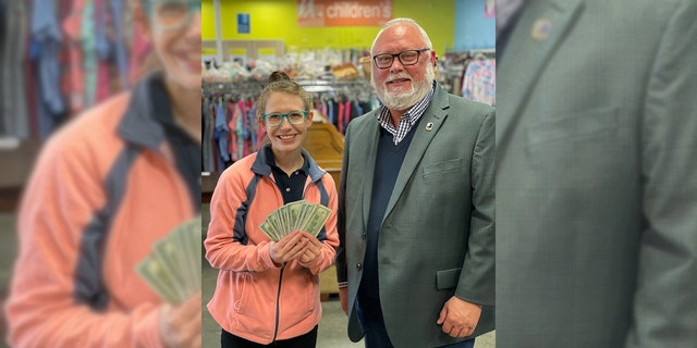 Frank Holland, the Goodwill VP of Donated Goods, presented Lessing with the cash reward.