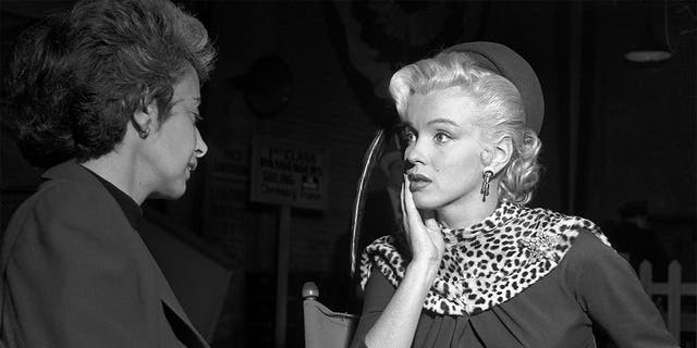 """Actress Marilyn Monroe and her acting coach Natasha Lytess on the set of the film """"Gentlemen Prefer Blondes' in December 1952 in Los Angeles, California."""