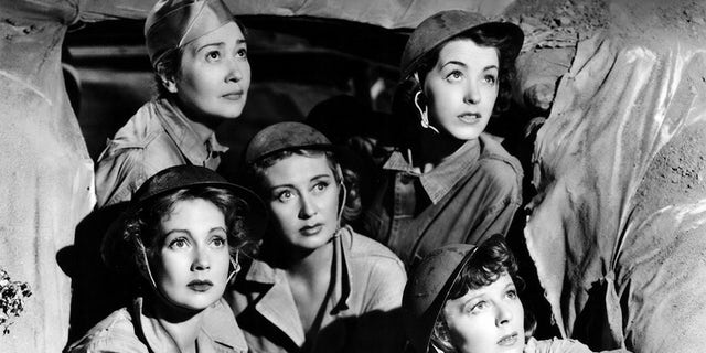 """Actress Ann Sothern, Fay Bainter, Joan Blondell, Marsha Hunt and Margaret Sullavan in a scene from the 1943 movie """"Cry 'Havoc''."""