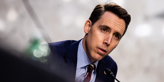 Senator Josh Hawley, a Republican from Missouri, speaks during a Senate Judiciary Committee hearing in Washington, D.C., U.S., on Tuesday, March 2, 2021. Hawley is among the lawmakers who will be skipping President Biden's joint address to Congress on April 28, 2021. Photographer: Graeme Jennings/Washington Examiner/Bloomberg via Getty Images
